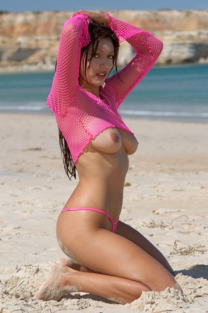 erotic fantasy: Sexy topless woman on beach