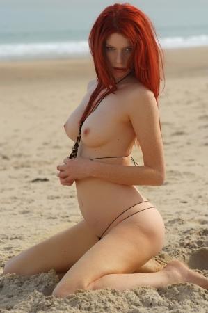 Sexy topless beach girl  Stock Photo
