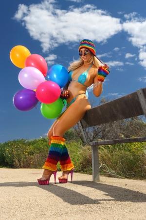 Sexy bikini girl with colorful balloons