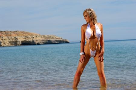 Sexy beach girl in mono bikini