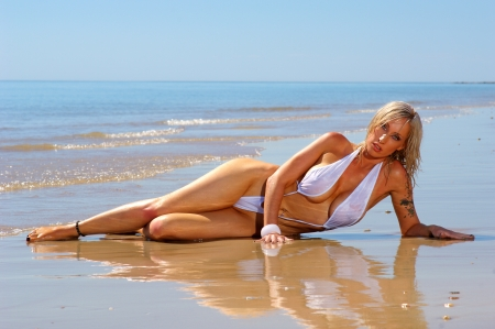 blonde bikini: Sexy beach girl in mono bikini