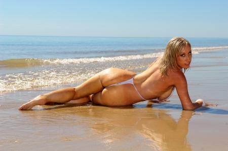 nakedness: Sexy beach girl in mono bikini