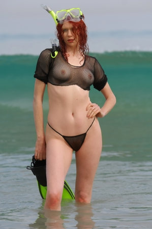 Sexy beach girl wearing scuba gear  photo
