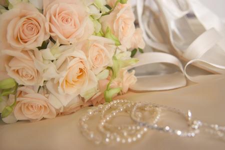 Wedding bouquet, shoes,  dress   Foto de archivo