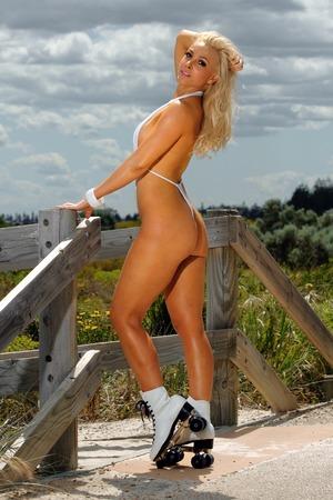 rollerskates: Sexy micro-bikini girl on rollerskates