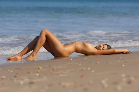 Sexy nude beach girl photo