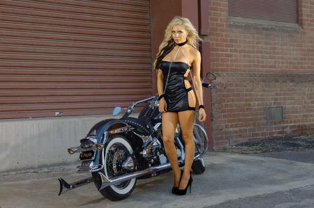 biker girl: Sexy motorcycle biker girl wearing leather