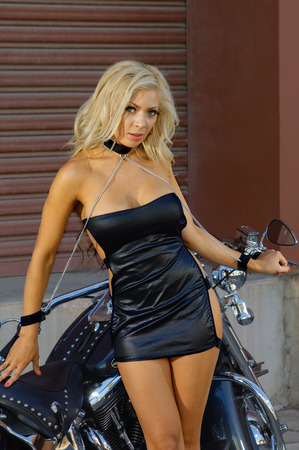 sexy school girl: Sexy motorcycle biker girl wearing leather