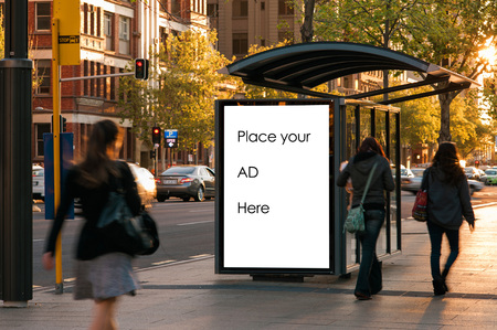 with stop sign: Outdoor advertising bus shelter Stock Photo