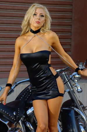 sexy woman: Sexy motorcycle biker girl wearing leather