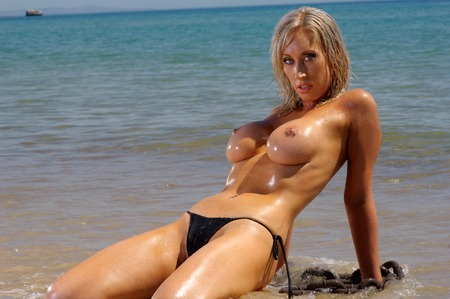bare breast: Sexy topless beach girl