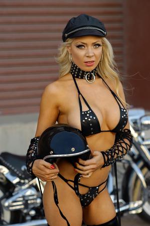 motor cycle: Sexy motorcycle biker girl wearing leather