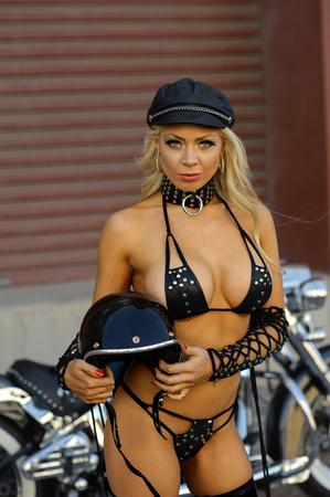 old school bike: Sexy motorcycle biker girl wearing leather