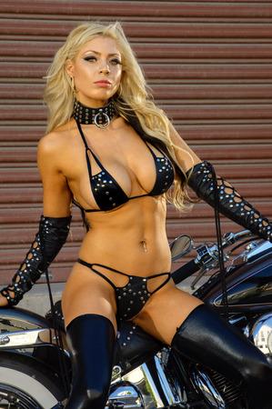 motor bikes: Sexy motorcycle biker girl wearing leather