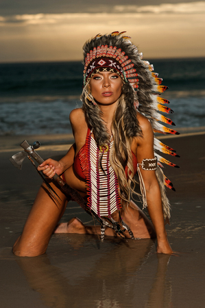 indian headdress: Sexy woman wearing American Indian war bonnet