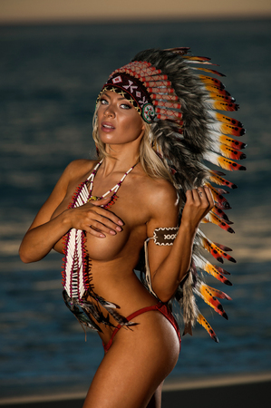 chief: Sexy woman wearing American Indian war bonnet