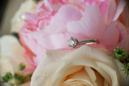bride's engagement ring on her wedding bouquet
