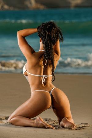 erotic fantasy: Sexy beach g-string bikini girl Stock Photo