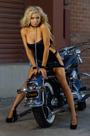 old motorcycle: Sexy motorcycle biker girl wearing sexy dress Stock Photo