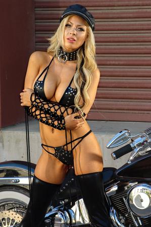 Sexy motorcycle biker girl wearing leather