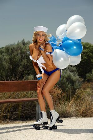 nakedness: Sexy blonde girl on rollerskates and balloons
