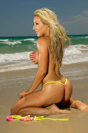 Sexy blonde beach bikini girl