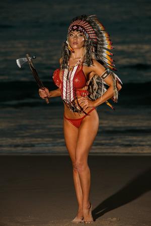 Sexy woman wearing American Indian war bonnet