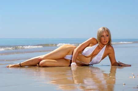 Sexy beach g-string bikini girl photo