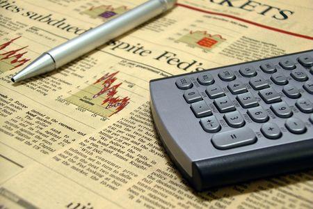 randomness: Financial newspaper, a calculator and a pen