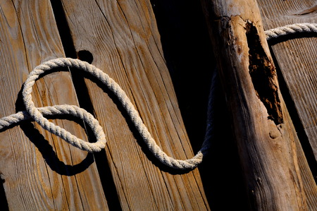 sailor rope and knot on wooden pier at the seaside.