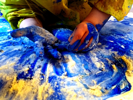 closeup of children hands painting during a school activity - learning by doing, education and art, art therapy concept. Reklamní fotografie