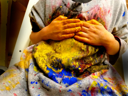 closeup of children hands painting during a school activity - learning by doing, education and art, art therapy concept. Zdjęcie Seryjne