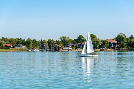 View on lake Chiemsee by Seebruck port, marina with boats, sailboats. Bavaria, Bayern, Germany