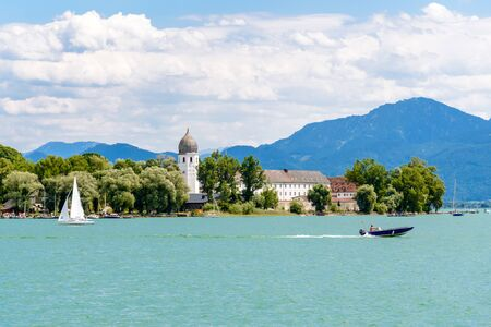 Fraueninsel, Frauenchiemsee on lake Chiemsee with boat, Sailboat, church, monastery. Bavaria, Bayern, Germany Stock Photo