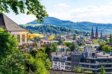 Aerial view on church, city of Freiburg im Breisgau, Beer garden, Schwarzwald mountains. Baden-Württemberg, Germany. Stock fotó