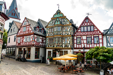 29 August 2019: Colorful Half-timbered (Fachwerkhaus) house, houses, cafe, restaurants, peaple on marketplace in Idstein, Hessen (Hesse), Germany. Nearby Frankfurt am Main, Wiesbaden