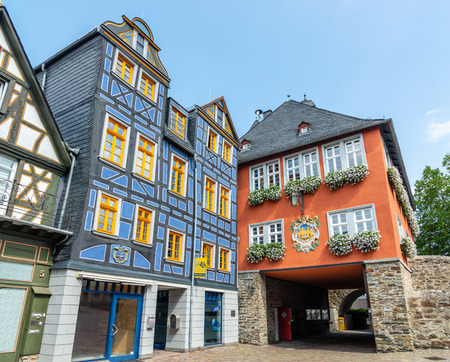29 August 2019: Town Hall, blue colorful Half-timbered (Fachwerkhaus)  house, houses on marketplace in Idstein, Hessen (Hesse), Germany. Nearby Frankfurt am Main, Wiesbaden Редакционное