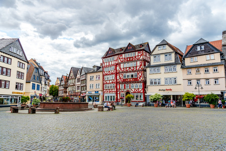 1 August 2019: Market place, square (Marketplace, Marktplatz) with half-timbered colorful houses, peaple in old town Butzbach, Hessen, Germany