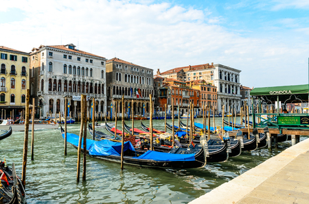 11 July 2013: Beautiful view on grand canal nearby Rialto bridge with boats, gandolas in Venice, Italy. Editorial