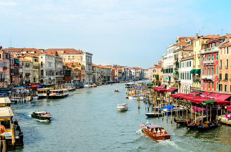 11 July 2013: Beautiful view on grand canal with boats, gandola in Venice, Italy.