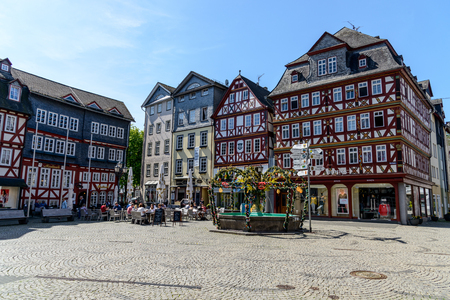 Herborn, Germany April 22 2019: Half-timbered houses on Marketplace (Marktplatz) in Herborn. Hessen, Germany