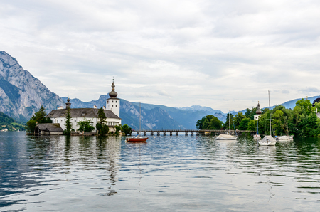 Castle Ort in Gmunden on Traunsee (lake Traun) with boats, Sailboats in  Salzkammergut nearby Salzburg, Traunkirchen,  Austria. Beautiful postcard view.
