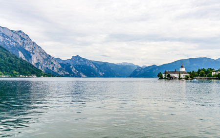 Castle Ort in Gmunden on Traunsee (lake Traun) with boats, Sailboats in  Salzkammergut nearby Salzburg, Traunkirchen Austria.