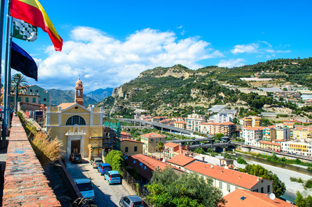 VENTIMIGLIA, Italy- August 17 2014: View on the city, town, mountains with blue sky, italian riviera. Border with France, Cote de Azur.