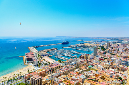 View on port harbor marina in Alicante with cruise ship, boats and yachts from Castle Santa Barbara. Spain.