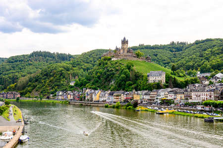 Cochem. Beautiful historical town on romantic Moselle, Mosel river. City view with Reichsburg castle on a hill. Rhineland-Palatinate, Germany, Banco de Imagens