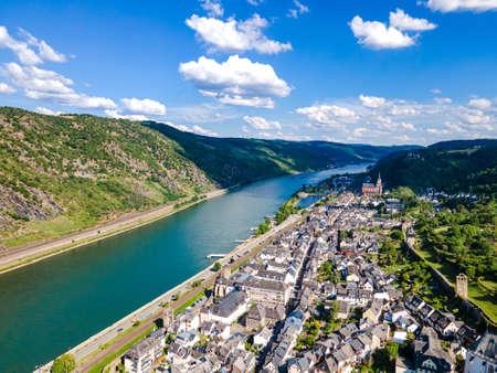 Aerial view on Oberwesel am Rhein. Small town on the upper middle Rhine River, Middle Rhine. Beautiful panoramic postcard with blue sky, clouds. Rhineland-Palatinate (Rhineland-Palatinate), Germany.