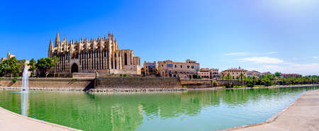 Palma de Mallorca, Spain. Cathedral Church, lake with blue sky. Panorama view
