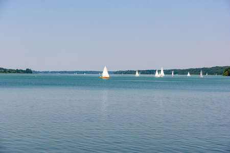 View on Ratzenburger See. Lake with boats, sailboats, blue sky. Schleswig Holstein, Ratzenburg, Germany