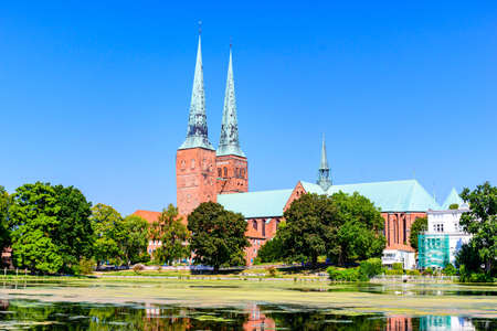 Catherdal church (Dom) with a lake, blue sky in Lubeck (Lübeck), Schleswig-Holstein, Germany